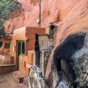 cave house with simply built pizza oven