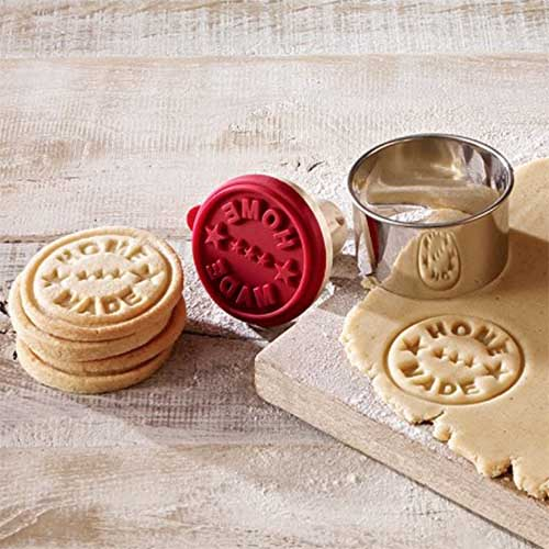 "cookie or biscuit cutter and stamp set, with the stencil ""100% home made"""