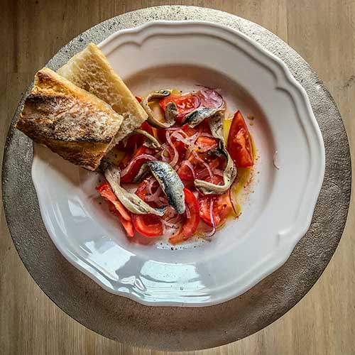 tomato and anchovy salad with red onions